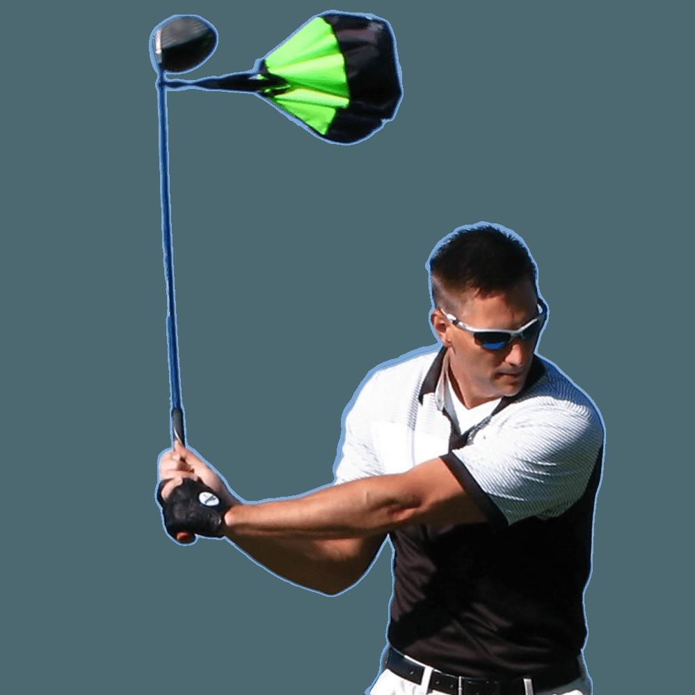 Golfer using the golf swing training chute by chute trainer.