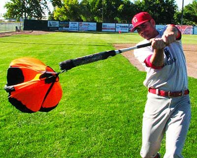 Orange chute swing trainer for baseball.